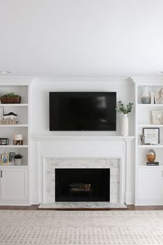 Looking to update your old fireplace? This step-by-step process takes you through how we transformed our old fireplace into a white marble tile fireplace that we absolutely love. Built In Around Fireplace, Tv Over Fireplace, Fireplace Tile Surround, Fireplace Update, Fireplace Bookshelves, Fireplace Built Ins, Marble Fireplaces, Fireplace Remodel, Living Room With Fireplace