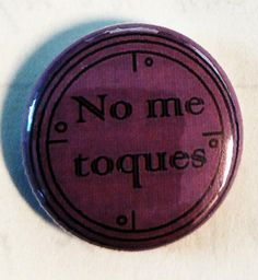 Purple No Me Toques 1 pin back button.  Get in touch for international rates.