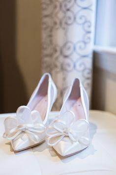 Classic white bow wedding shoes: http://www.stylemepretty.com/new-york-weddings/oyster-bay-new-york/2015/12/21/classic-summer-waterfront-wedding/   Photography: Ryon:Lockhart - http://www.ryonlockhart.com/