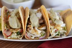 I'm popping in really fast today (wasn't planning on posting today but couldn't resist) to tell you I couldn't let one more day go by without shoving this broiled tilapia taco recipe in your face. Seafood Dishes, Seafood Recipes, Mexican Food Recipes, Cooking Recipes, Healthy Recipes, Fish Recipes, Meal Recipes, Recipies, Tilapia Tacos