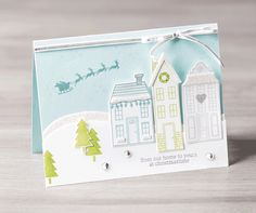Create your own wintery scene with the Holiday Home stamp set and coordinating framelit set.