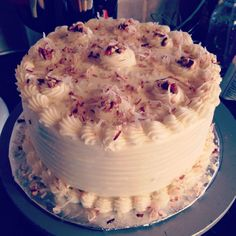 1 box of yellow or white cake mix . 3 large eggs , 1 1/4 cup of heavy cream  2 tsp vanilla , 1/2 stick of melted  butter .  Handful each of Pecans and coconut to the batter . Fill 2 8 inch pans bake 350 for 30 to 35 minutes  . Easy Italian cream cake  , Just add pecans and toasted coconut as garnishment .  Icing =  Block of cream cheese , Stick of butter , 2 tsp vanilla , Powdered sugar at least 4 cups , Add more if you desire thick icing