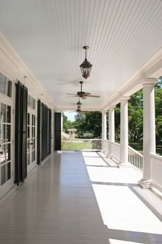 great width for a porch, blue ceiling, windows & doors with shutter on. Would have preferred white ceiling fans or Lanterns