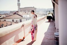 Love the way the colors of her dress mingle with the background. via PARK & CUBE