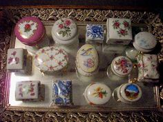 A collection of antique ring boxes that fit nicely on a silver tray.