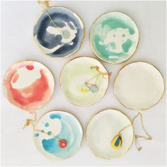 Handmade ceramic ring dish in white with a wash of watercolor glaze adorned with 22K gold edges