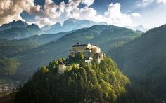 Hohenwerfen Castle in Austria is a stunning structure dating back more than 900 years. The castle wi. Hohenwerfen Castle, Austria, Kid Friendly Vacations, Family Vacations, Medieval, Beautiful Castles, Beautiful Places, City Architecture, Travel And Leisure