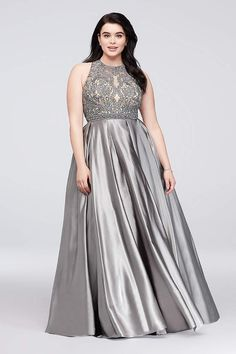 5983a20b7fb7a Super-lustrous satin forms the soft statement skirt of this formal plus-size  ball gown