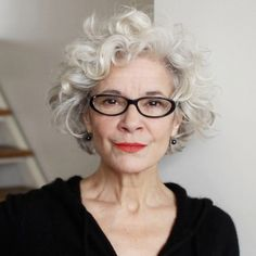 Grey curly hair. Dark glasses. Sm earrings. Looks like i'll need to start wearing lipstick...