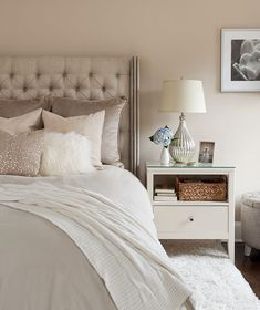 Bedroom: Fascinating Bedroom Design Ideas With Beige Color Canvas Tufted Headboard And Beige Wall Paint Featuring Bedside Table Built In Storage Drawer And Cozy Ottoman Combine With Table Lamp And Flowers Ornament Complete With White Shag Rug And Wall Mou