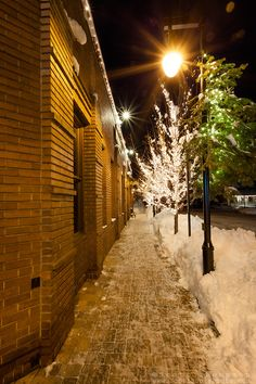"""Walkway in Downtown Truckee 1"" - This icy and snowy walkway was photographed along the Bar of America brick building in Downtown Truckee, California."