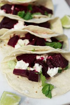 Beet and Goat Cheese Tacos with Avocado Cream for meatless Monday from The Girl In The Little Red Kitchen