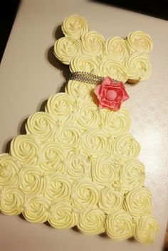 Brides Dress Pull-a-part Cake: white cupcakes with vanilla buttercream and a pink fondant flower.