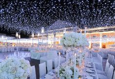 """Create a """"canopy"""" of string lights for your outdoor wedding. So pretty!"""