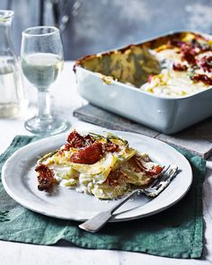 We've given dauphinoise potatoes a dreamy makeover. Thinly sliced potatoes are slow cooked in a creamy goat's cheese sauce, then topped with more goat's cheese and grated with parmesan, for good measure. Veg Dishes, Potato Dishes, Potato Recipes, Side Dishes, British Pudding, Tasty Vegetarian Recipes, Vegetarian Dinners, Vegetarian Cooking, Humble Potato