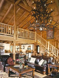 Log Home Great Rooms | Kentucky Log Home Great Room!!! Bebe'!!! Love this light fixture made of antlers!!!