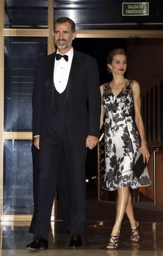 Queen Letizia and King Felipe held hands as they made their elegant entrance.