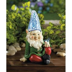 Cheery Garden Gnome Solar Statue - You'd be happy, too, if a friendly little bluebird was perched on your knee! This charming Cheery Garden Gnome Solar Statue features a tall blue hat that lights up at night after soaking up the sun all day long.