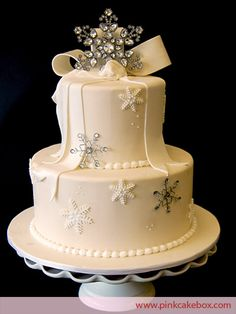 Two Tier Winter Wonderland Snowflake Cake by Pink Cake Box in Denville, NJ. More photos at http://blog.pinkcakebox.com/two-tier-winter-wonderland-cake-2009-12-05.htm #cakes