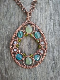 New Jade, Apatite, and Rainbow Moonstone Wire Wrapped Antique Copper Necklace with olive Swarovski crystals. $69.00, via Etsy.