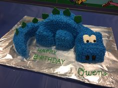 My very first cake of was for a friend and former coworker. She asked if I could make a dinosaur cake for her little boy, Owen. Owen wanted a blue dinosaur with green accents and made out … Dinosaur Cake Easy, Dinosaur Cakes For Boys, Dino Cake, Dinosaur Birthday Cakes, Dinosaur Party, 4th Birthday, Dinosaur Cake Tutorial, Dinosaur Cupcake Cake, Harry Birthday
