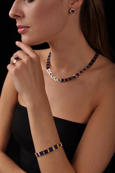 Masterpiece of 18K gold and Lapis Lazuli set Collier, ring, bracelet and earrings. Handmade Inlay work.