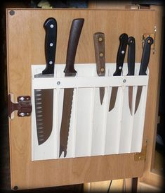 An alternative to a knife block on the counter or using up a drawer for sharp knives.