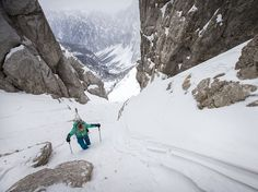 Picture of a skier climbing out of a mountain pass in the Julian Alps of Slovenia