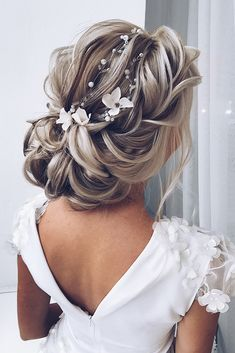 timeless bridal hairstyles elegant textured airy updo with white flowers on blonde hair ellen_orlovskay