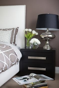 That lamp is awesome! Love the flowers, headboard and nightstand too