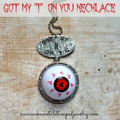 """DIY Eyeball Necklace Tutorial from Metal Stamped Jewelry. Don't have a metal stamping kit? Skip the """"Got my I on you"""" and just make the eyeball pendant. The """"eyeballs"""" are eyeball ping pong balls from the Dollar Tree and come in bags."""