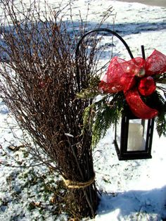 branches were tied to a lantern-holding yard hook Itsy Bits and Pieces: The Bachman's Holiday Ideas House Part 3...