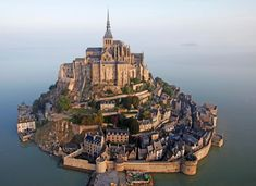 Castles, Châteaux, and Fortresses - Content concerning historic fortifications and palaces. Mt St Michel, Mont Saint Michel France, St Micheal, Vacation Places, Vacations, Exotic Places, Fantasy Landscape, France Travel, European Travel