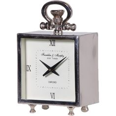 Silver brushed steel mantle clock with handle and four silver feet Made of solid steel with a rough cut brushed finish and high quality reflective