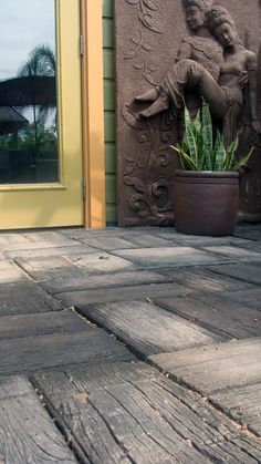 http://biggrassliving.com/products/wood-grain-concrete-pavers