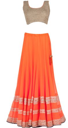 Neon orange lehenga with dull gold crushed blouse .