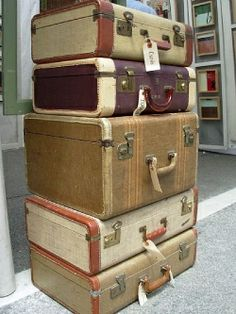 Stack of vintage suitcases...look at that huge one in the middle!