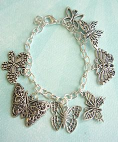 this bracelet features butterfly Tibetan silver charms - a silver plated zinc alloy metal which is lead and nickel free the charms are attached to a silver tone 7.5 inches chain bracelet.