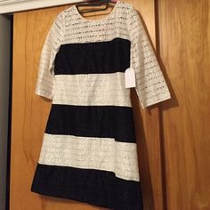 NWT Jessica Simpson Dress NWT   Brand: Jessica Simpson  Size: 8                  Black & White striped dress, lace overlay, at the knee, square cut back/gold zipper (see second pic).    Will consider offers. Jessica Simpson Dresses Midi