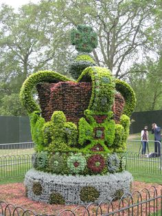 Diamond Jubilee Topiary Crown, St James' Park, London, England      Just one of the many decorations marking the Queen's Diamond Jubilee in London this summer. This gigantic bushy crown is a replica of St Edward's Crown, the crown actually (and only) used at the coronation ceremony. It is almost 10 feet tall (3 meters) and stands in St James' Park, London's prettiest park, just a stone's throw from Buckingham Palace.