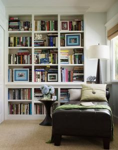 This large built-in bookcase found a home in an unused corner of a master bedroom. A chaise longue completes the space to create a cozy reading nook. Storage Solutions Bedroom, Interior, Home, Home Libraries, Bookshelves, Remodeling Projects, Built In Bookcase, Small Remodel, Corner Bookshelves