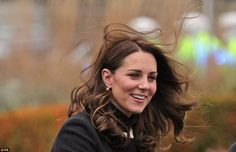 Windswept and interesting! The Duchess battles the elements after arrivingat the Land Rover. Nov 22 2017, black Goat coat, third pregnancy. blast of wind catches hair