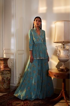 Green printed hand embroidered angrakha style peplum top paired with a highlighted print lehenga in georgette Pakistani Dresses, Indian Dresses, Indian Outfits, Ethnic Outfits, Indian Attire, Indian Wear, Indian Designer Outfits, Designer Dresses, Designer Clothing