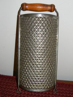 Vintage Tin Grater With Wooden Handle. $10.50, via Etsy.