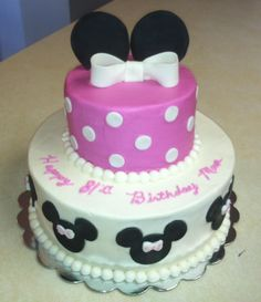 Minnie Mouse cake. Buttercream cake with fondant accents.