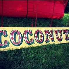 This coconut shy contains everything from the coconuts to the bucket of balls. Painted Signs, Hand Painted, Fete Ideas, Village Fete, Vintage Circus, Vintage Carnival, Summer Fair, Holiday Club, School Displays