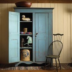 Large cupboards like this are like closets. They are excellent for storing everything such as linens, kitchen-wares, food, dishes, books. -CW-