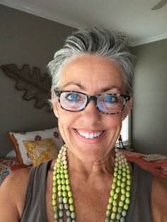 Short sassy silver gray hair. Salt and pepper gray hair. Grey hair. White hair. Granny hair. No dye. Dye free. Aging and going gray gracefully.