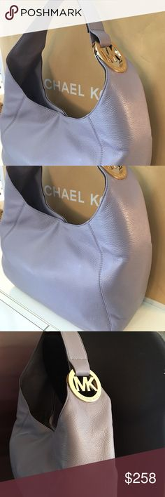 MICHAEL KORS NEW LAVENDER HOBO 100% AUTHENTIC MICHAEL KORS NEW WITH TAGS NEVER USED LARGE LAVENDER HOBO BAG 100% AUTHENTIC.  LOVELY BAG AND STUNNING COLOR.  THIS LAVENDER PEBBLE LEATHER HOBO BAG IS A EYE CATCHER.  A LARGER HOBO TO ACCOMMODATE ALL OF YOUR NEEDS. THIS BAG MEASURES 14 INCHES WIDE BY 12 INCHES TALL WITH A 10 INCH SHOULDER STRAP DROP Michael Kors Bags Hobos