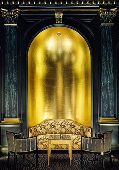 Sitting area at The London Savoy hotel. Dramatic dark peacock blue and rich opulent gold leaf.